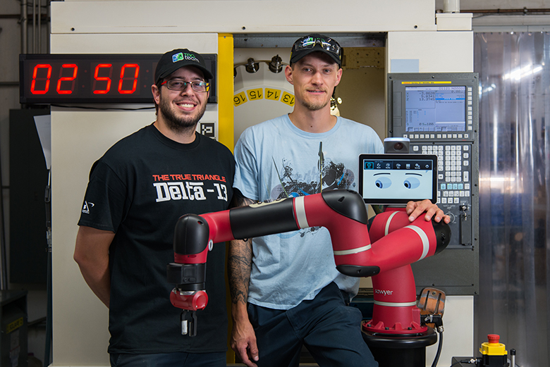 Tag team posing with Sawyer the robot