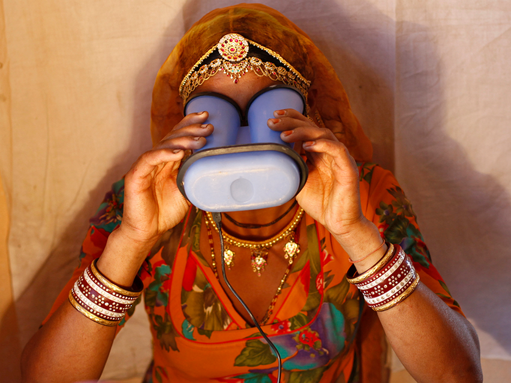 Woman using an iris scanner for UIDAI Aadhaar registration. Image: Reuters