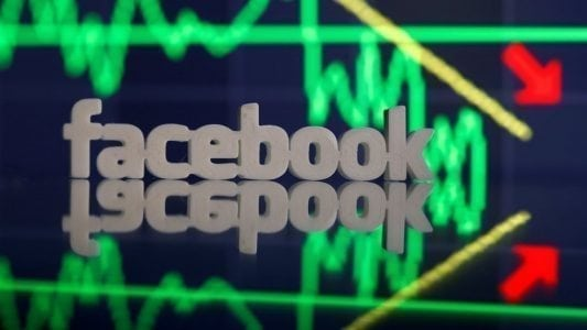 A 3D-printed Facebook logo is seen in front of displayed stock graph in this illustration photo March 20, 2018. Picture taken March 20. REUTERS/Dado Ruvic - RC1E83A25650