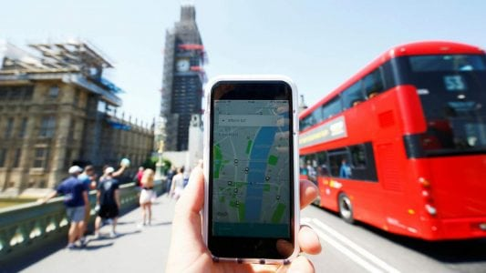 Uber app and a bus in London. Image: Reuters