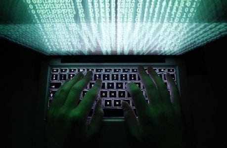 A man types on a computer keyboard in Warsaw in this February 28, 2013 illustration file picture. (REUTERS/Kacper Pempel/Files / MANILA BULLETIN)