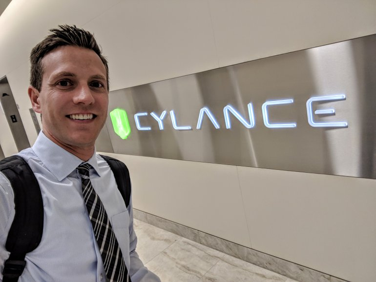 rich demuro in front of a cylance sign