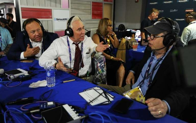 Alex Jones (L), of Infowars, and Roger Stone, a former Donald Trump advisor, debate with Jonathan Alter during an episode of Alt