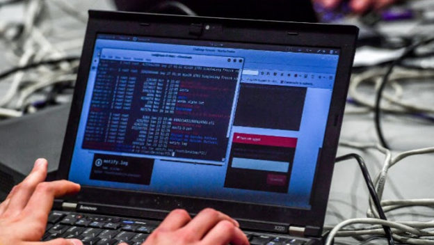 A person works at a computer during the 10th International Cybersecurity Forum in Lille in January 2018. Online crime is a concern in South Africa. Photo: AFP /PHILIPPE HUGUEN