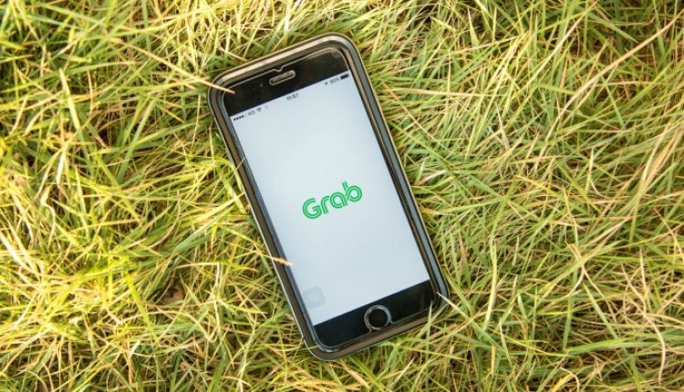 Grab teams up with Singapore Power to roll out 200 electric vehicles | Singapore