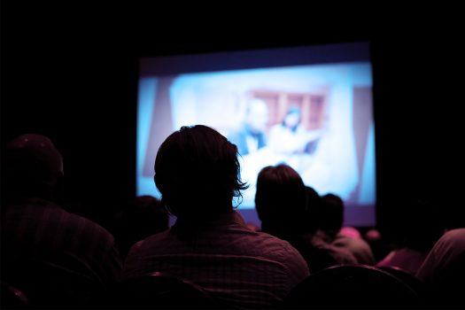 Two people watching a film