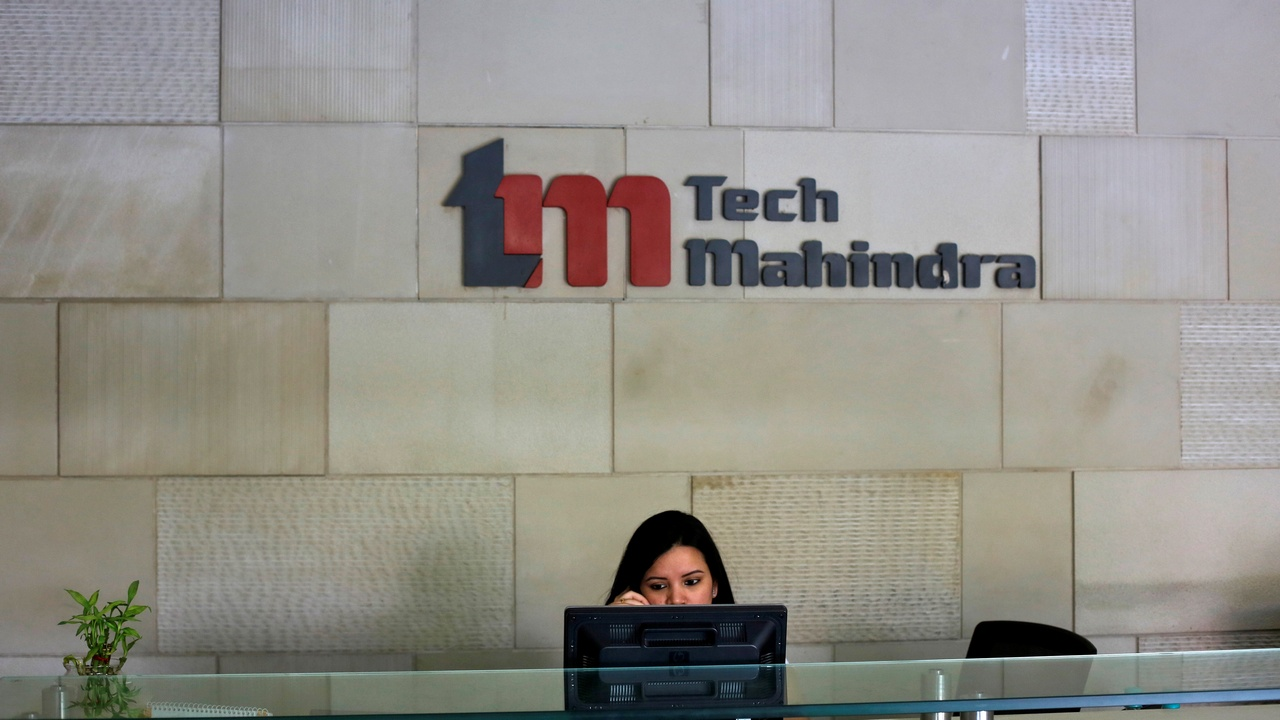 An employee sits at the front desk inside Tech Mahindra office building in Noida on the outskirts of New Delhi March 18, 2013. India's IT outsourcers are promoting