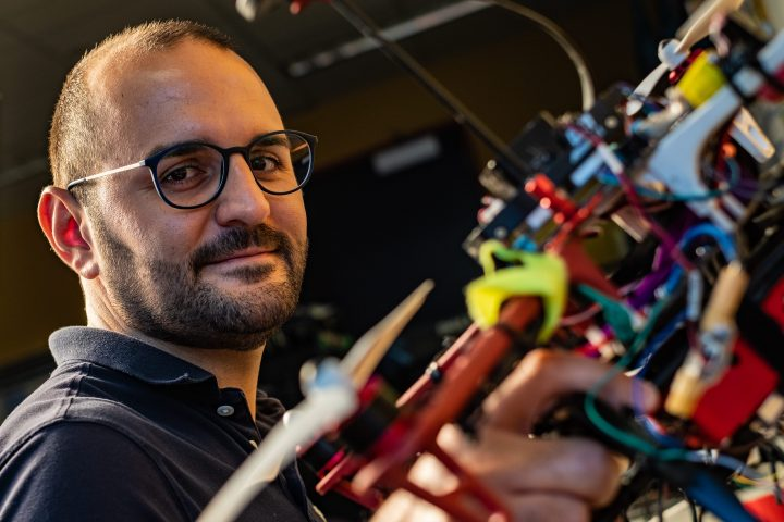 Rice University postdoctoral researcher Riccardo Petrolo shows one of several autonomous aerial drones being prepared to monitor for pollutants. The National Science Foundation awarded a grant to the Rice lab of electrical and computer engineer Edward Knightly to develop the platform. (Credit: Jeff Fitlow/Rice University)