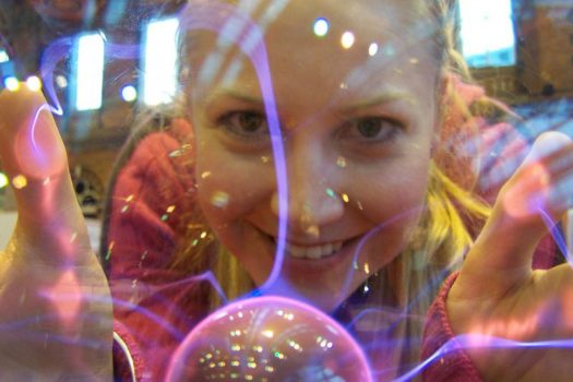 Melanie looking at us through one of those plasma balls people buy in shops