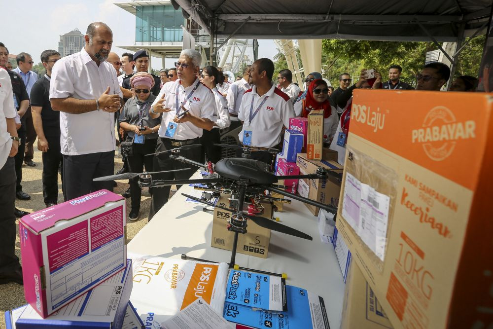 Communications and Multimedia Minister Gobind Singh Deo visits the drone exhibition during the Parcel Drone Competition in Putrajaya March 7, 2019. ― Picture by Yusof Mat Isa