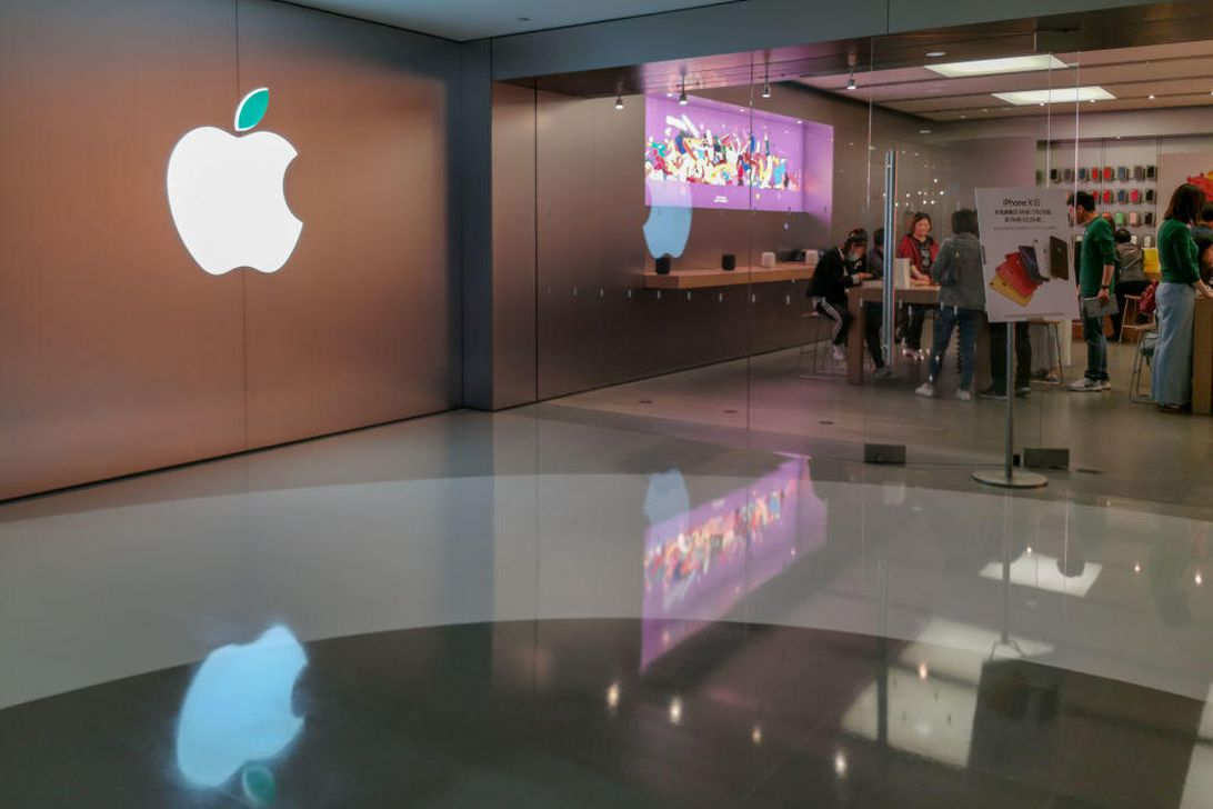 Customers gather at an Apple store.