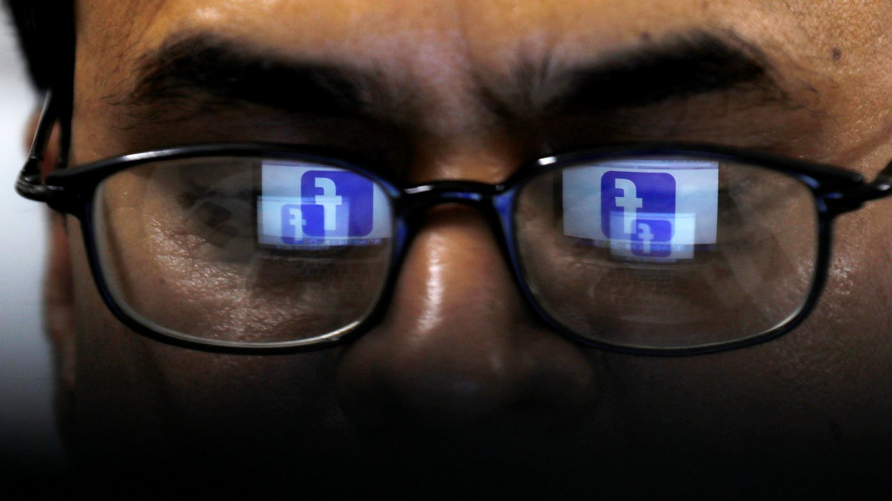 Facebook logo is reflected in glasses. Reuters
