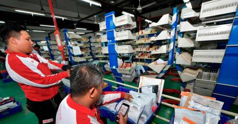 Pos Malaysia sinks to the red in Q4