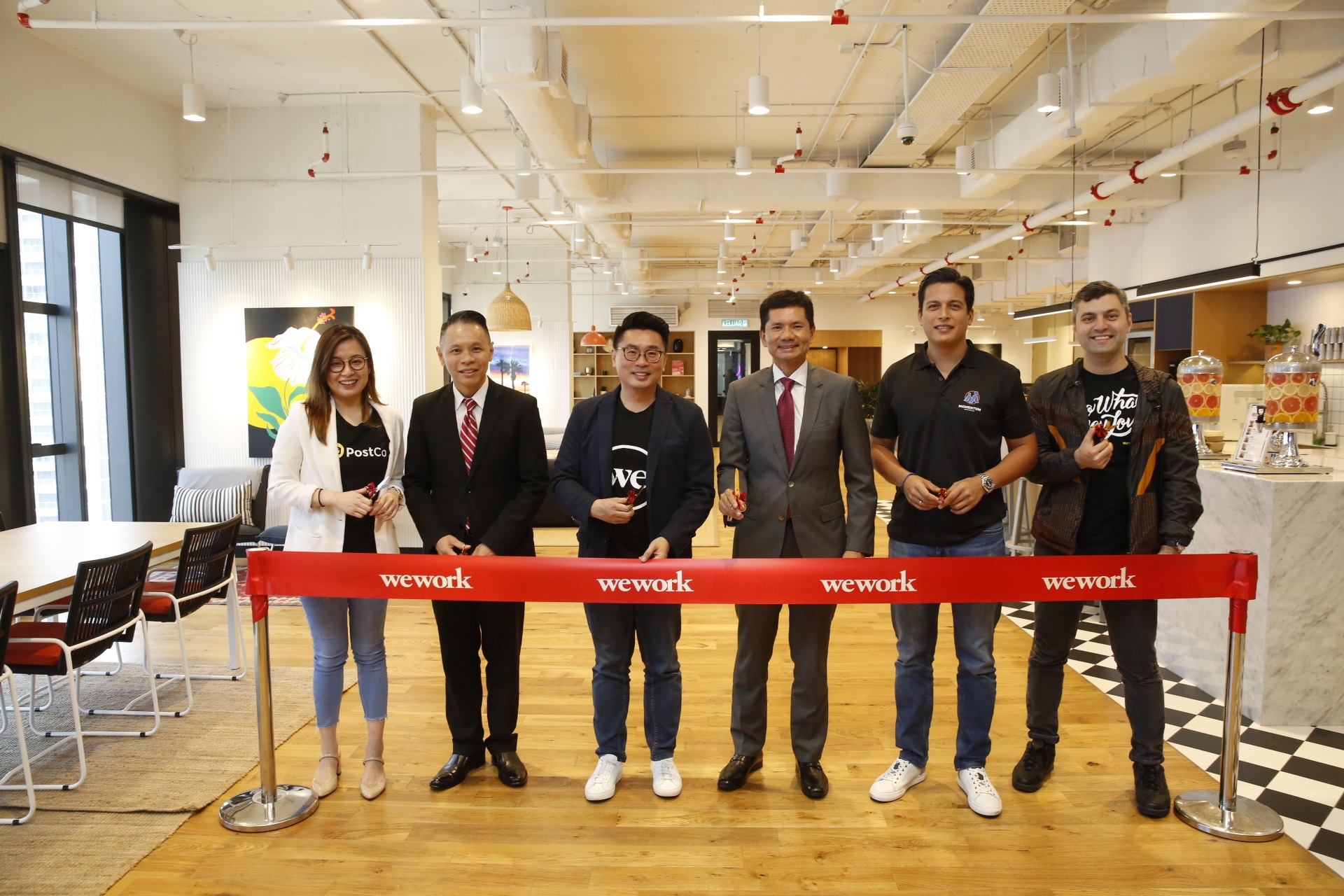 """(From left) InvestKL Investor Relations - Americas & Europe director & head Dennis Tan; PostCo co-founder & COO Melisa Wang; WeWork Southeast Asia MD Turochas """"T"""" Fuad; InvestKL CEO Zainal Amanshah; Momentum Commerce founder & CEO Hans-Peter Ressel; and WeWork Southeast Asia head of Community and Member Experience Eyad Zahra"""