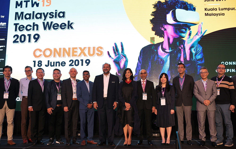 Minister of Multimedia and Communications Malaysia Gobind Singh Deo (7th from left) with MDEC CEO Surina Shukri (8th from left) and the MTW19 partners and sponsors