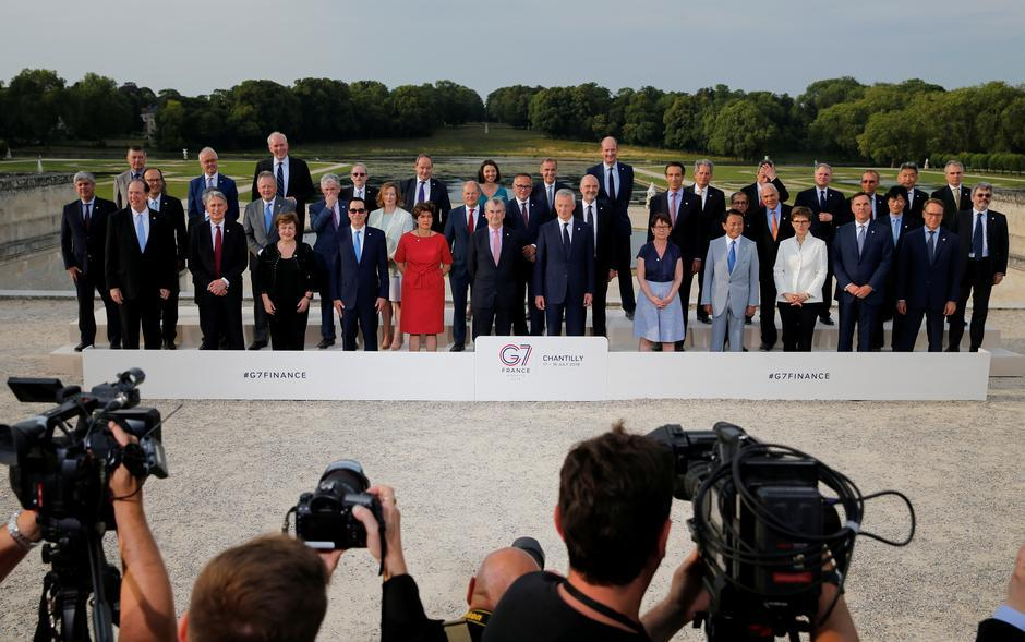 """FintechJuly 18, 2019 / 7:34 AM / Updated 15 hours ago G7 urges tough Libra regulation, agrees to tax digital giants Leika Kihara, David Lawder 4 Min Read CHANTILLY, France (Reuters) - Digital currencies such as Facebook's planned Libra raise serious concerns and must be regulated as tightly as possible to ensure they do not upset the world's financial system, Group of Seven finance ministers and central bankers said on Thursday. Finance Minister Bruno Le Maire of France, which holds the rotating presidency of the G7 top world economies, told a news conference the group opposed the idea that companies could have the same privilege as nations in creating means of payment - but without the control and obligations that go with it. Related Coverage Stablecoins like Libra must be held to highest standards: G7 G7 finance chiefs agree to tackle digital tax challenges: summary """"We cannot accept private companies issuing their own currencies without democratic control,"""" Le Maire said. In a summary of the informal G7 talks in Chantilly, north of Paris, the French presidency said the ministers and governors had agreed that """"stablecoins and other various new products currently being developed, including projects with global and potentially systemic footprint such as Libra, raise serious regulatory and systemic concerns"""". Governments are starting to worry that big tech companies are encroaching on areas that belong to governments, such as issuing currency. Facebook's June 18 announcement of Libra heralded an effort to expand beyond social networking and move into e-commerce and global payments. The G7 are concerned that Facebook's ambitions for a digital currency might not only weaken their control over monetary and banking policies but also pose security risks. """"A global stablecoin for retail purposes could provide for faster and cheaper remittances, spur competition for payments and thus lower costs, and support greater financial inclusion,"""" European Central Bank board member B"""