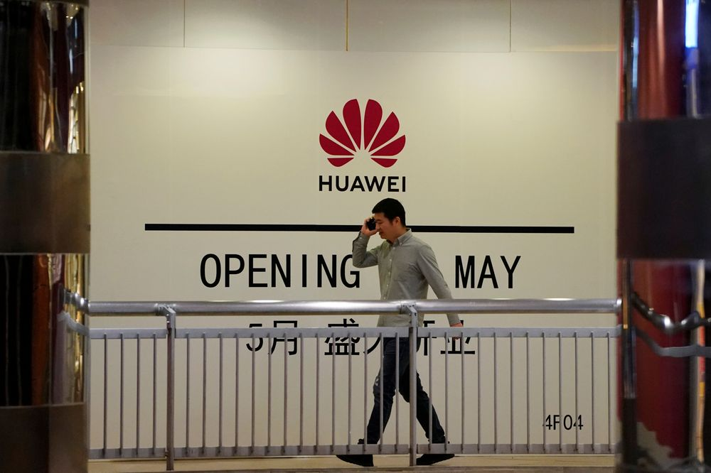 A man using his mobile phone walks past a yet-to-open Huawei store inside a shopping mall in Shanghai, China May 16, 2019. — Reuters pic