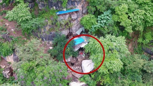 Drones spotted the cave on a steep hillside