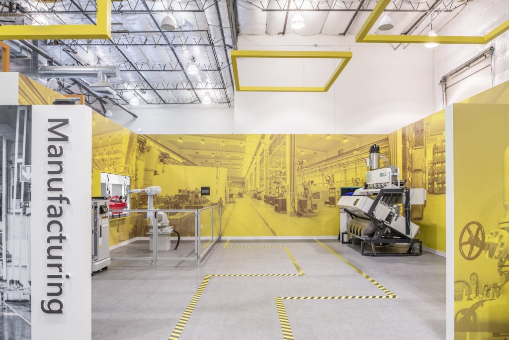 An optical sorter from Bühler and a compact industrial robot from ABB in the manufacturing area of Microsoft's new Industry Experience Center.