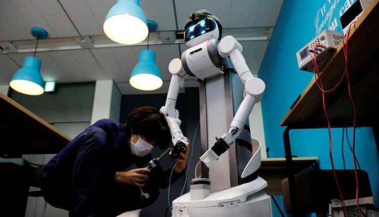 Japan's aging workforce robots become virus fighters