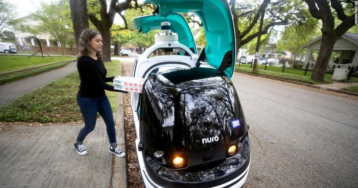 Domino launching pizza delivery robot car